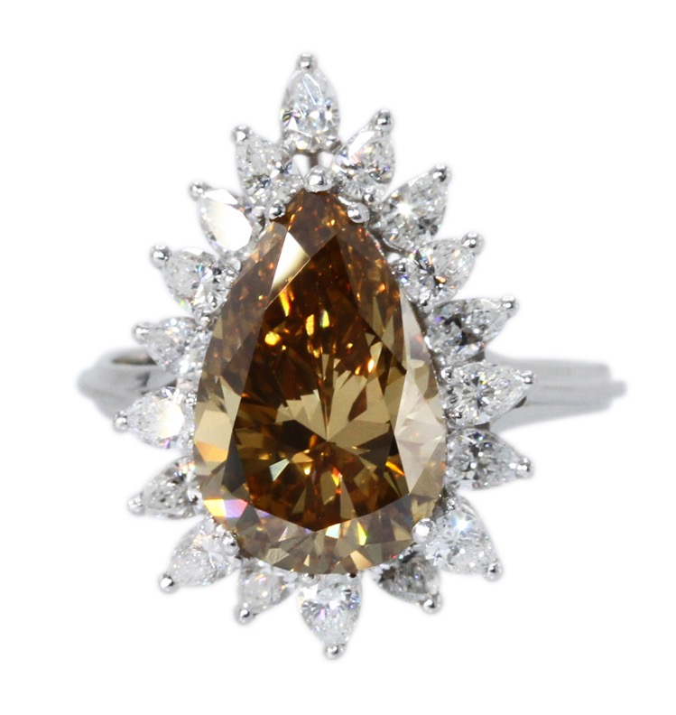 Platinum, Fancy Deep Brown-Yellow Diamond and Diamond Ring
