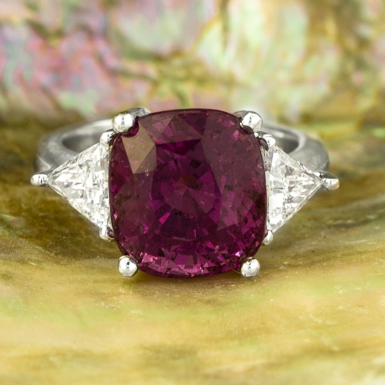 A Platinum, Purple-Pink Sapphire and Diamond Ring