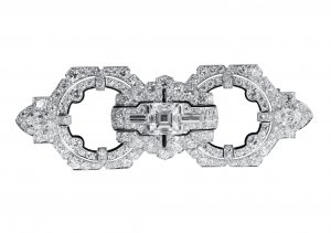 Art Deco platinum, diamond and black enamel brooch by Cartier