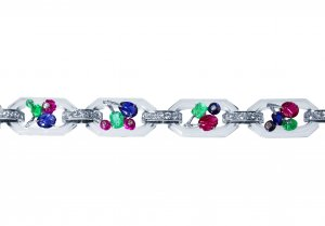 Art Deco platinum, 18 karat white gold, rock crystal, diamond, and carved colored stone 'Tutti Frutti' bracelet by Cartier