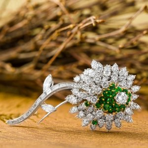Platinum, Diamond and Emerald Flower Brooch by Kurt Wayne